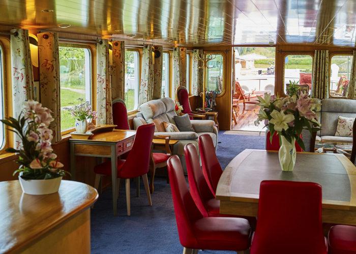 C'est La Vie Luxury Hotel Canal Barge dining area alternative view