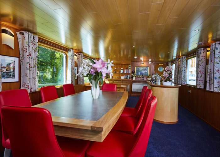 C'est La Vie Luxury Hotel Canal Barge living bar and dining area