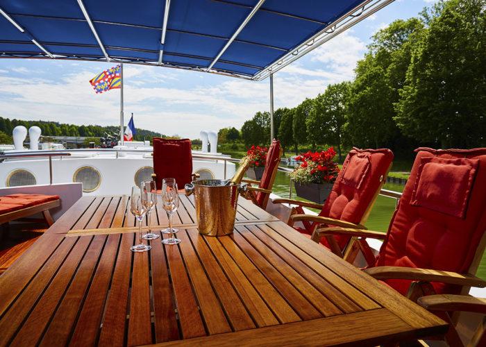 C'est La Vie Luxury Hotel Canal Barge exterior sun deck dining area